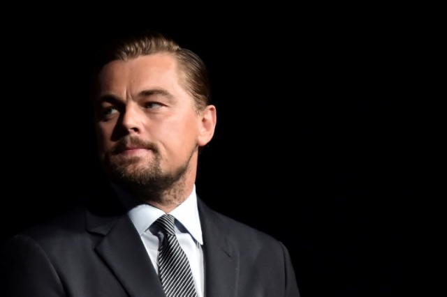 US actor Leonardo DiCaprio looks on prior to speaking on stage during the Paris premiere of the documentary film