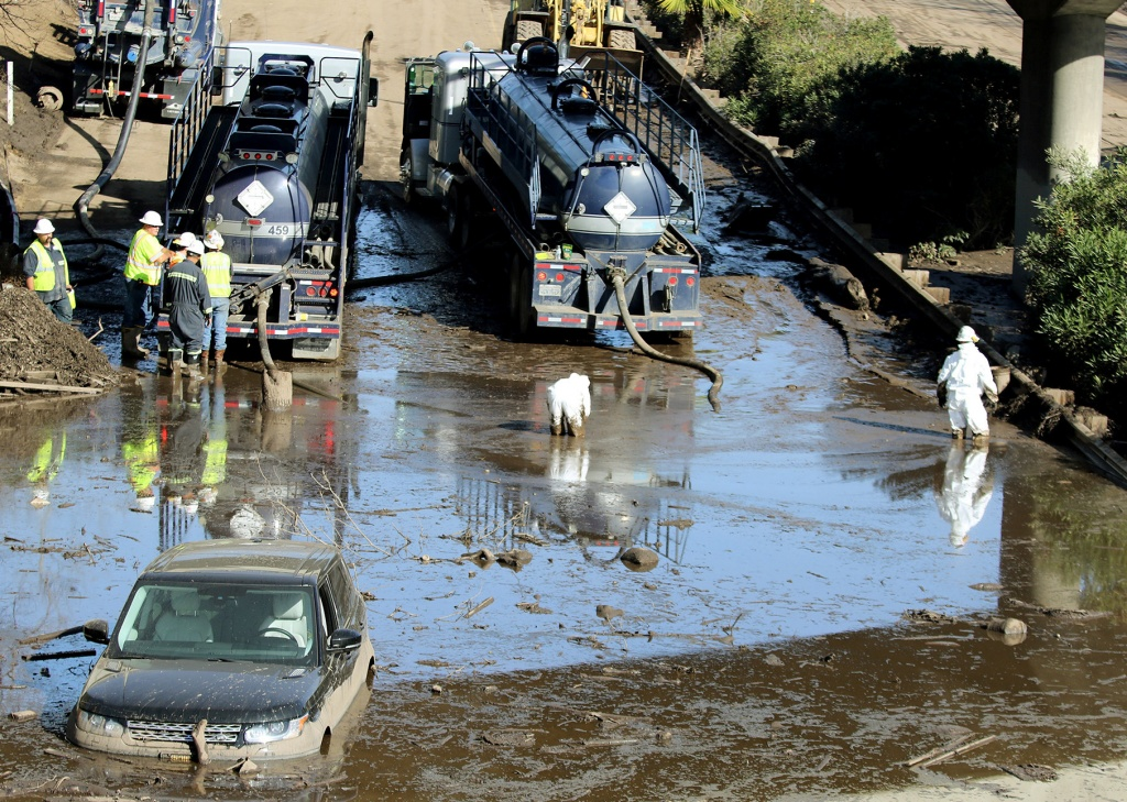 Crews begin clean-up efforts of Highway 101 after mudslides cause extensive damage to hundreds of buildings and caked highways with sludge, in Montecito