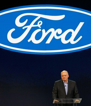 Jim Hackett (L), President and CEO of Ford Motor Company, speaks at the Ford press preview at the North American International Auto Show in Detroit