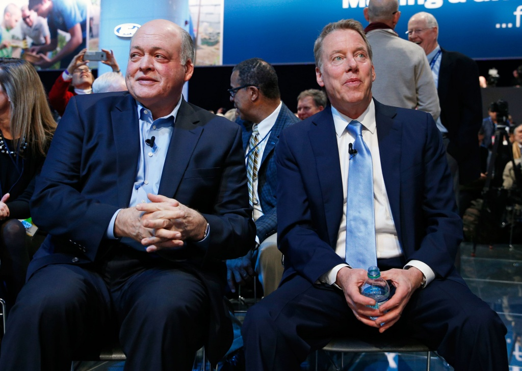 Bill Ford, executive chairman of the Ford Motor Company and Jim Hackett (L), President and CEO, await the Ford press preview at the North American International Auto Show in Detroit