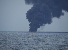 Flames and smoke from the Iranian oil tanker Sanchi is seen in the East China Sea