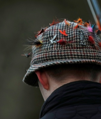 Lures are seen on an angler's hat on the opening day of the salmon fishing season on the River Tay at Kenmore in Scotland