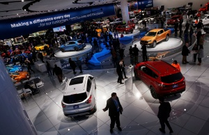 Reporters and guests visit the North American International Auto Show in Detroit