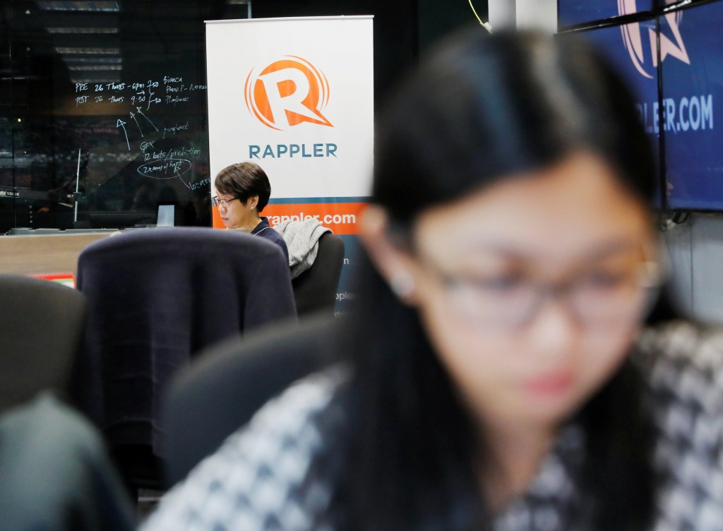 Journalists work at the office of Rappler in Pasig