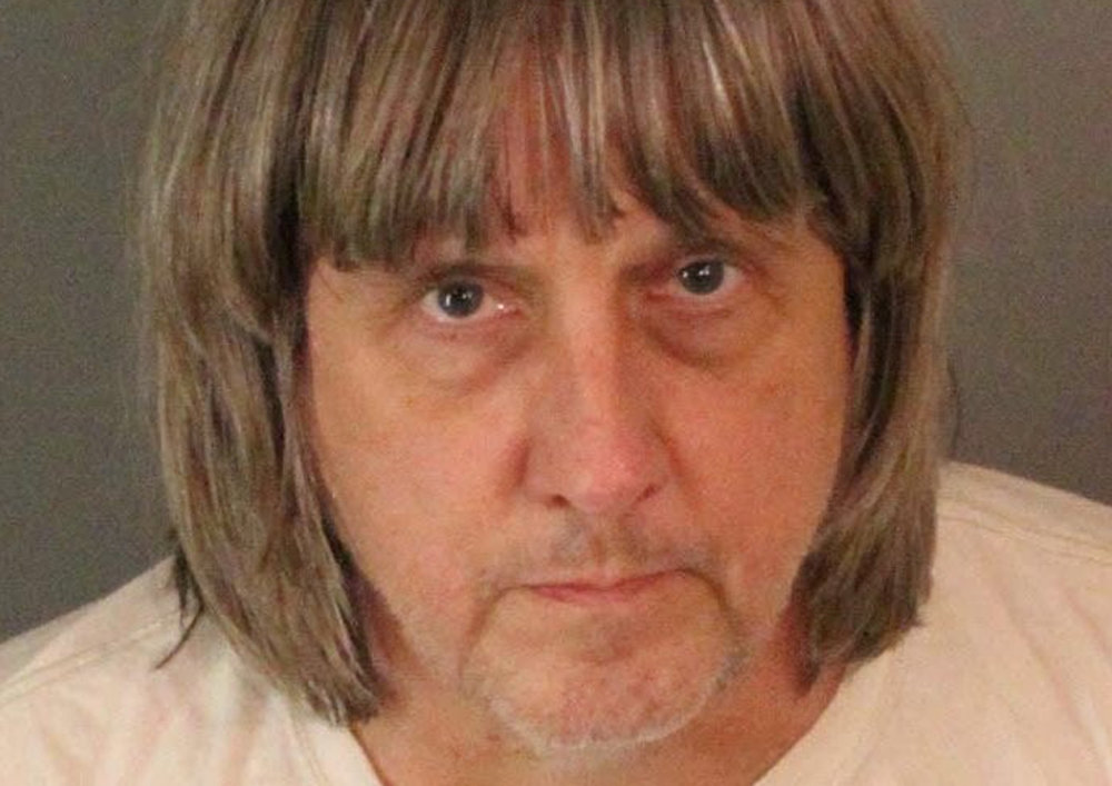 Turpin appears in a police booking photo in Riverside