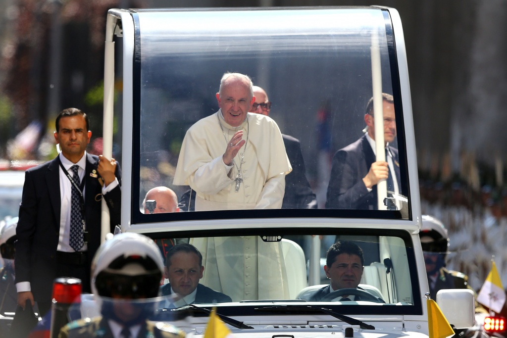 Pope Francis waves to the crowd while arriving to the Cathedral of Santiago, in Santiago,