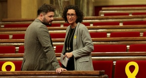 Rovira, General Secretary of Republican Left of Catalonia (ERC), talks to ERC's deputy Rufian before the start of the first session of Catalan Parliament after the regional elections in Barcelona