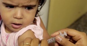 A health agent vaccinates a child during a campaign of vaccination against yellow fever in Sao Paulo