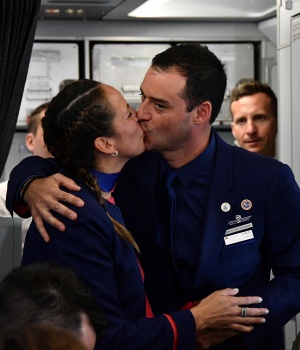 Crew members Paula Podest and Carlos Ciuffardi kiss after being married on board by Pope Francis during the flight between Santiago and the northern city of Iquique
