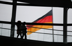 Visitors walk inside the glass dome of the Reichstag building