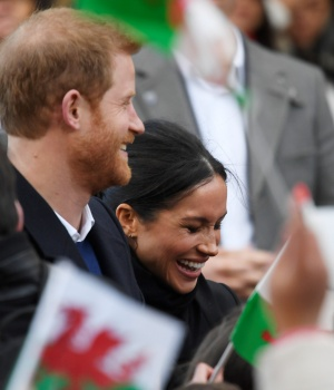 Crowds greet Britain's Prince Harry and his fiance Meghan Markle during a visit to Cardiff Castle in Cardiff