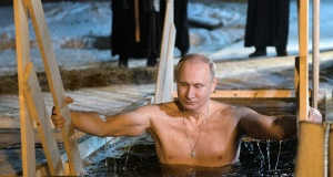 Russian President Vladimir Putin takes a dip in the water during Orthodox Epiphany celebrations at lake Seliger, Tver region