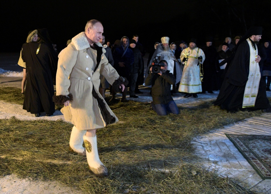 Russian President Vladimir Putin walks to take a dip in the water during Orthodox Epiphany celebrations at lake Seliger, Tver region