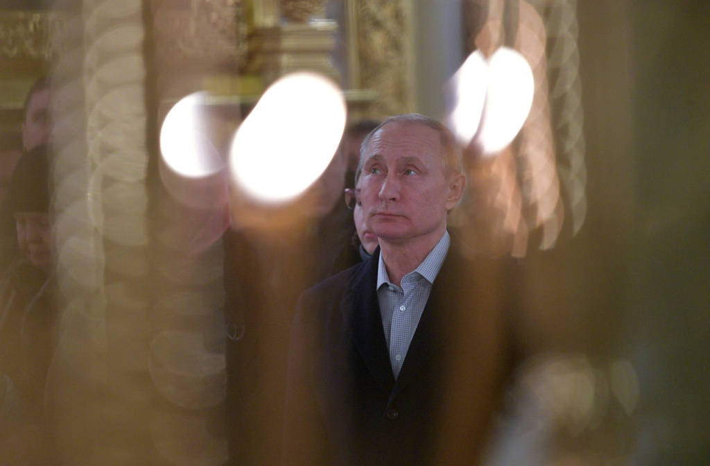 Russian President Vladimir Putin attends a service for Orthodox Epiphany celebrations at the Nilov monastery on Stolobny Island on lake Seliger in the Tver Region