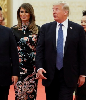 U.S. President Donald Trump and first lady Melania arrive for the state dinner with China's President Xi Jinping and China's first lady Peng Liyuan at the Great Hall of the People in Beijing