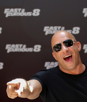 """Actor Vin Diesel reacts as he poses during a photocall to promote his film """"Fast & Furious 8"""" in Madrid"""