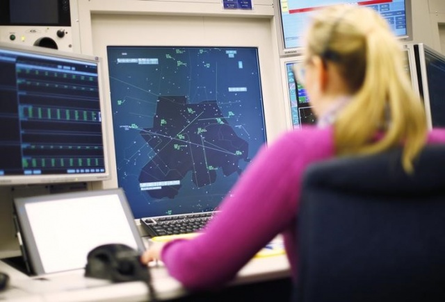 An operator of Swiss air traffic control firm Skyguide monitors airplanes at the Skyguide monitoring centre in Duebendorf