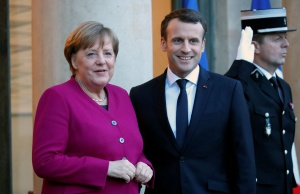 French President Emmanuel Macron greets German Chancellor Angela Merkel upon her arrival at the Elysee Palace in Paris