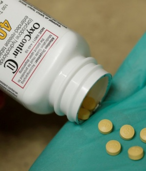 A pharmacist holds prescription painkiller OxyContin at a local pharmacy in Provo