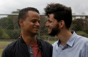 Roberth Castillo and Mario Arias, speak after a news conference to announce the suspension of their wedding scheduled for this Saturday, after notaries refused to recognize same-sex marriage, at La Sabana park in San Jose