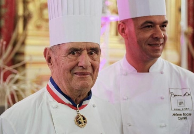 Famous French chef Bocuse poses with his son Jerome in Lyon