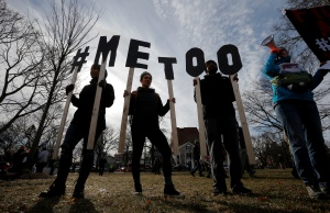 """Demonstrators spell out """"#METOO"""" during the local second annual Women's March in Cambridge"""