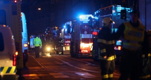Firefighters work at the scene of a fire at a hotel in Prague