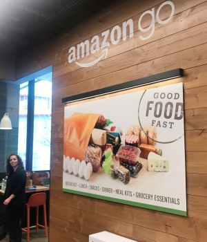 Signage is seen inside Amazon's first cash register-free grocery store, in Seattle