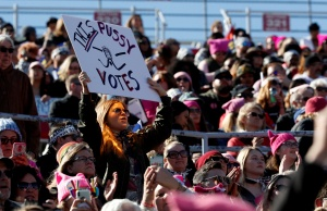 Bianca Greene of Los Angeles holds up her sign during the Women's March rally in Las Vegas