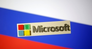 3D-printed Microsoft logo is seen on a displayed Russian flag in this illustration