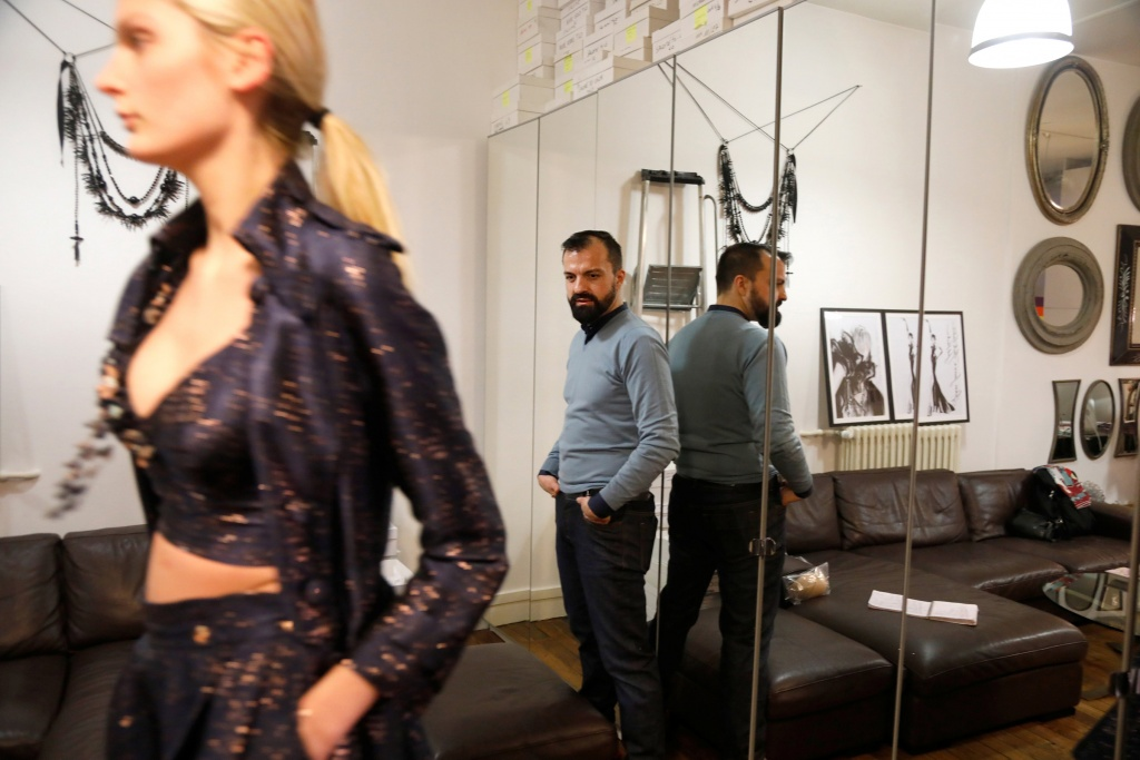 French designer Julien Fournie looks at model Manon during a fitting at his workshop ahead of his Spring-Summer 2018 Haute Couture fashion show presentation in Paris