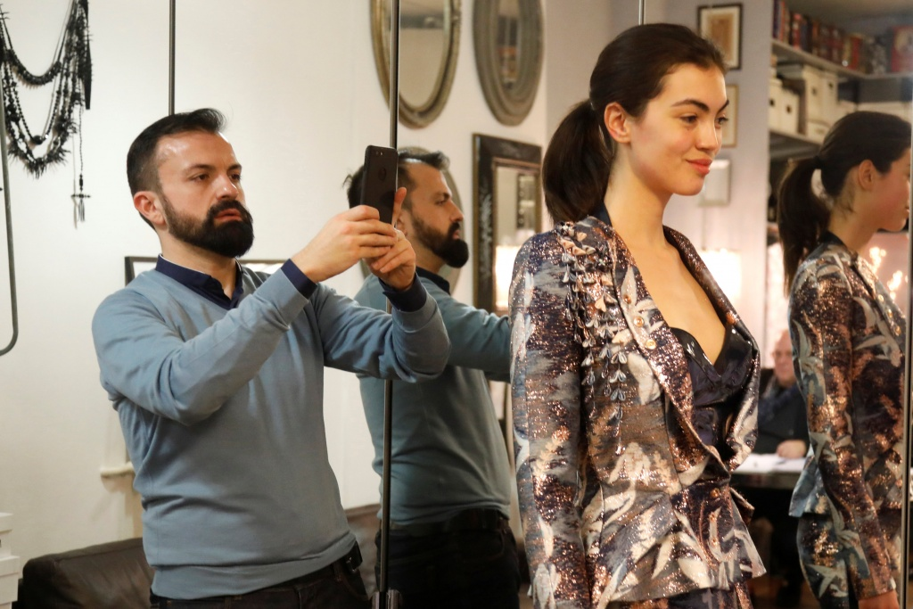 French designer Julien Fournie takes pictures of model Daphne during a fitting at his workshop ahead of his Spring-Summer 2018 Haute Couture fashion show presentation in Paris