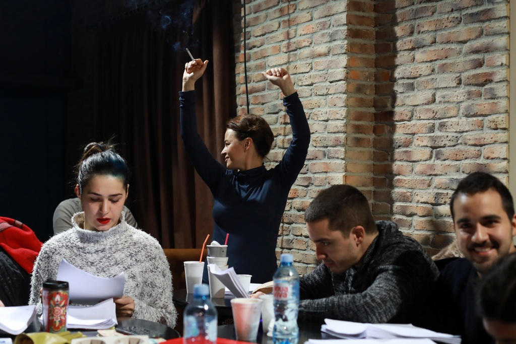 "Writer Bogavac raises her hands during a text rehearsal of her play ""The Slobodan Show"" in Belgrade"