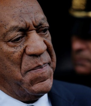 Actor and comedian Bill Cosby looks on as he departs after a judge declared a mistrial in his sexual assault trial at the Montgomery County Courthouse in Norristown