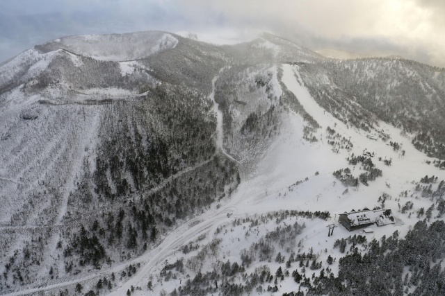 A cable car station, where skiers were awaiting rescue, and the volcano that erupted in the Kusatsu-Shirane mountains are seen from a Kyodo News helicopter in the Gunma Prefecture