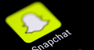 The Snapchat messaging application is seen on a phone screen