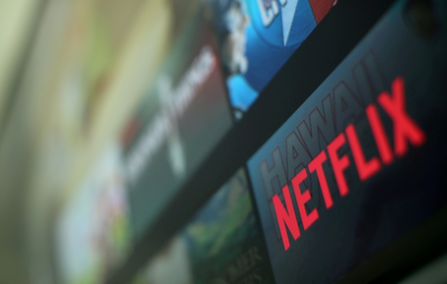 The Netflix logo is pictured on a television in this illustration photograph taken in Encinitas California