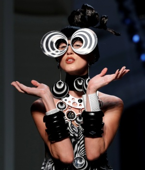 A model presents a creation by French designer Jean Paul Gaultier as part of his Haute Couture Spring-Summer 2018 fashion collection in Paris