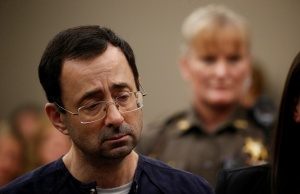 Larry Nassar, a former team USA Gymnastics doctor who pleaded guilty in November 2017 to sexual assault charges, stands during his sentencing hearing in Lansing