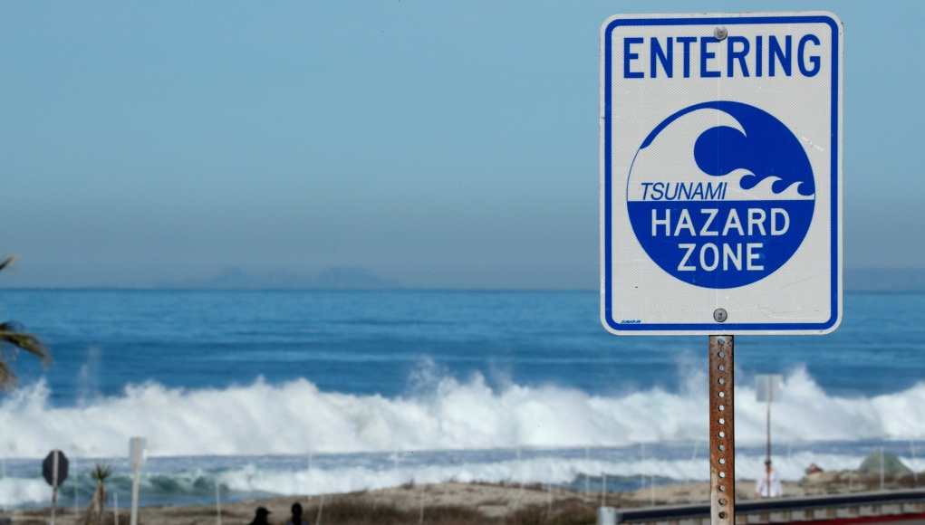 A tsunami sign is shown along the coastal highway in Cardiff, California
