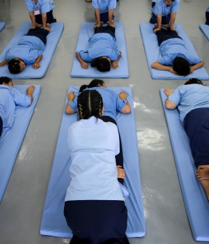Women prisoners attend a Thai massage class at Chiang Mai Women's Correctional Institute, in Chiang Mai