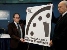"""Krauss and Pickering of the Bulletin of Atomic Scientists reveal """"Doomsday Clock"""" adjustment during a news conference at the National Press Club in Washington"""