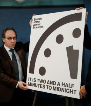 "Krauss and Pickering of the Bulletin of Atomic Scientists reveal ""Doomsday Clock"" adjustment during a news conference at the National Press Club in Washington"
