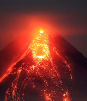 Lava flows from the crater of Mount Mayon volcano during a new eruption in Legazpi city