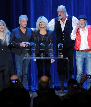 Former U.S. President Bill Clinton (L) and Neil Portnow (R), President & CEO of The Recording Academy, stand with honorees (2nd L-2nd R) Stevie Nicks, Lindsey Buckingham, Christine McVie, Mick Fleetwood, and John McVie during the 2018 MusiCares Person of t