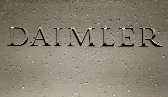 Daimler AG sign with raindrops is pictured before company's annual news conference in Stuttgart