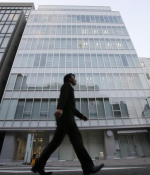 A man walks past a building where Mt. Gox is housed in Tokyo