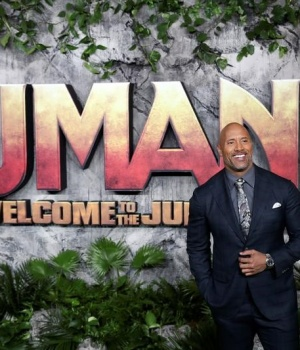 Actor Dwayne Johnson poses for photographers as he arrives for the UK premiere of 'Jumanji: Welcome to the Jungle', at the Vue West End, Leicester Square, central London