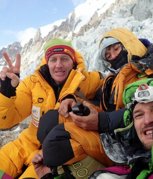 Denis Urubko, Elisabeth Revol, and Adam Bielecki pose for a picture at the base of the Diamir Face of Nanga Parbat