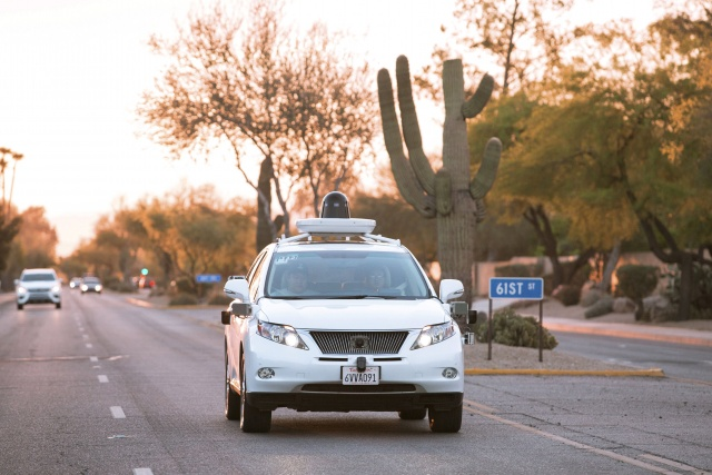 Test drivers use a Lexus SUV built as a self-driving car to map the area prior to a journey without a driver in control in Phoenix